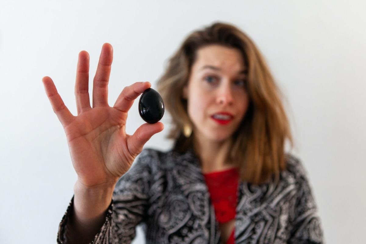 woman holds jade egg