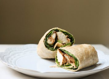chicken wrap on a blue plate