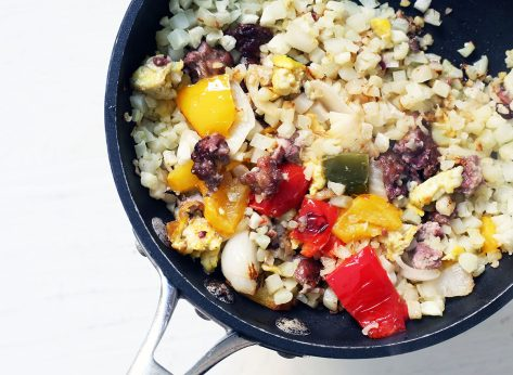 Whole30 breakfast cauliflower rice with veggies, eggs, and bacon