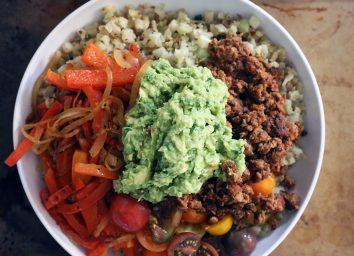 whole 30 burrito bowl with guacamole on top