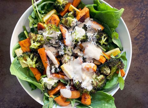 whole 30 roasted vegetable salad with tahini dressing in white bowl