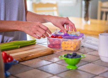 Packing a meal prep lunch with atkins snack