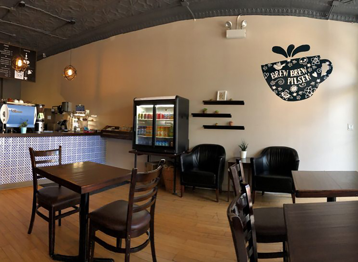 interior of brew brew coffee and tea in chicago with wooden tables and chairs