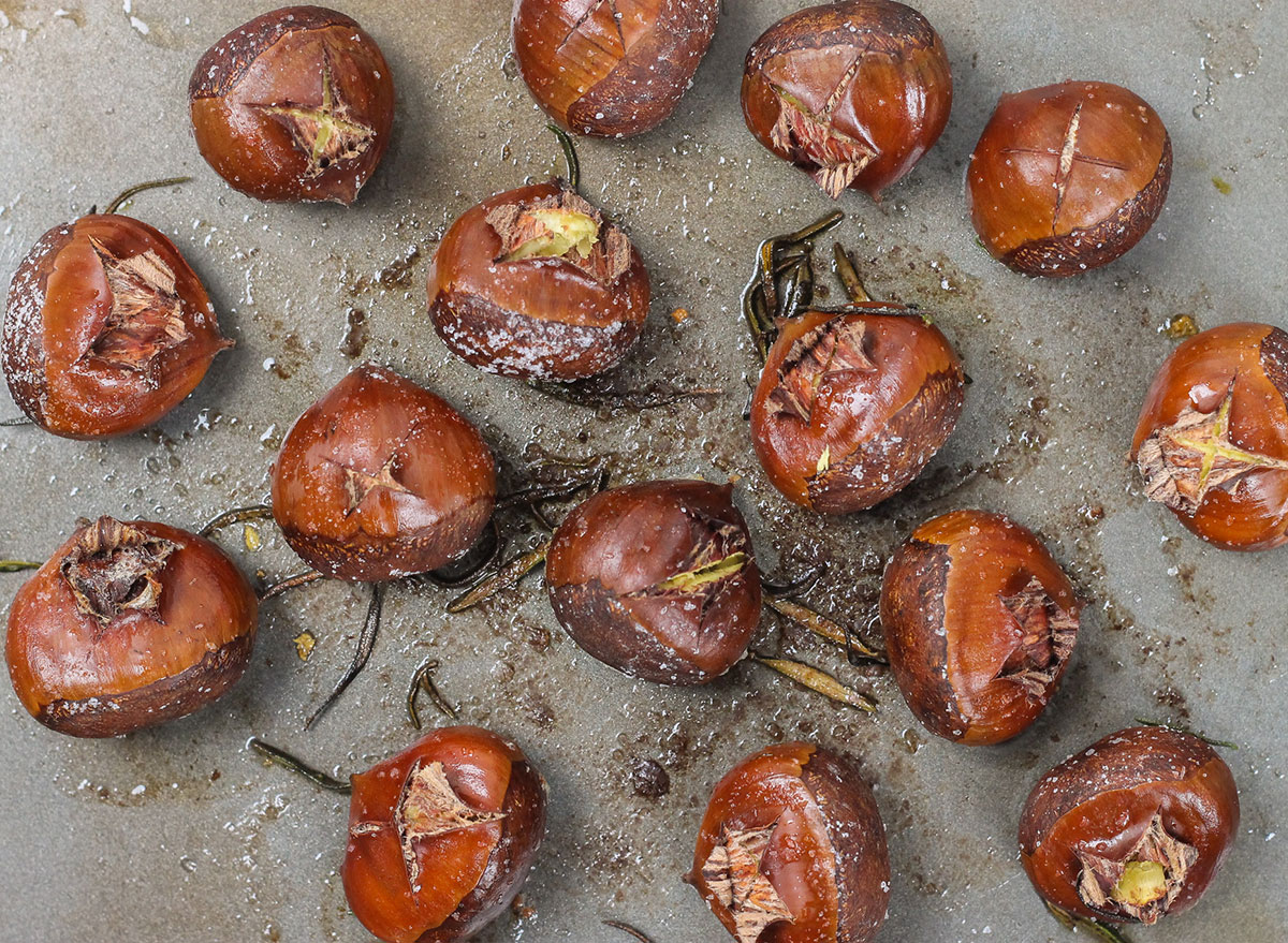 roasted chestnuts on a baking sheet