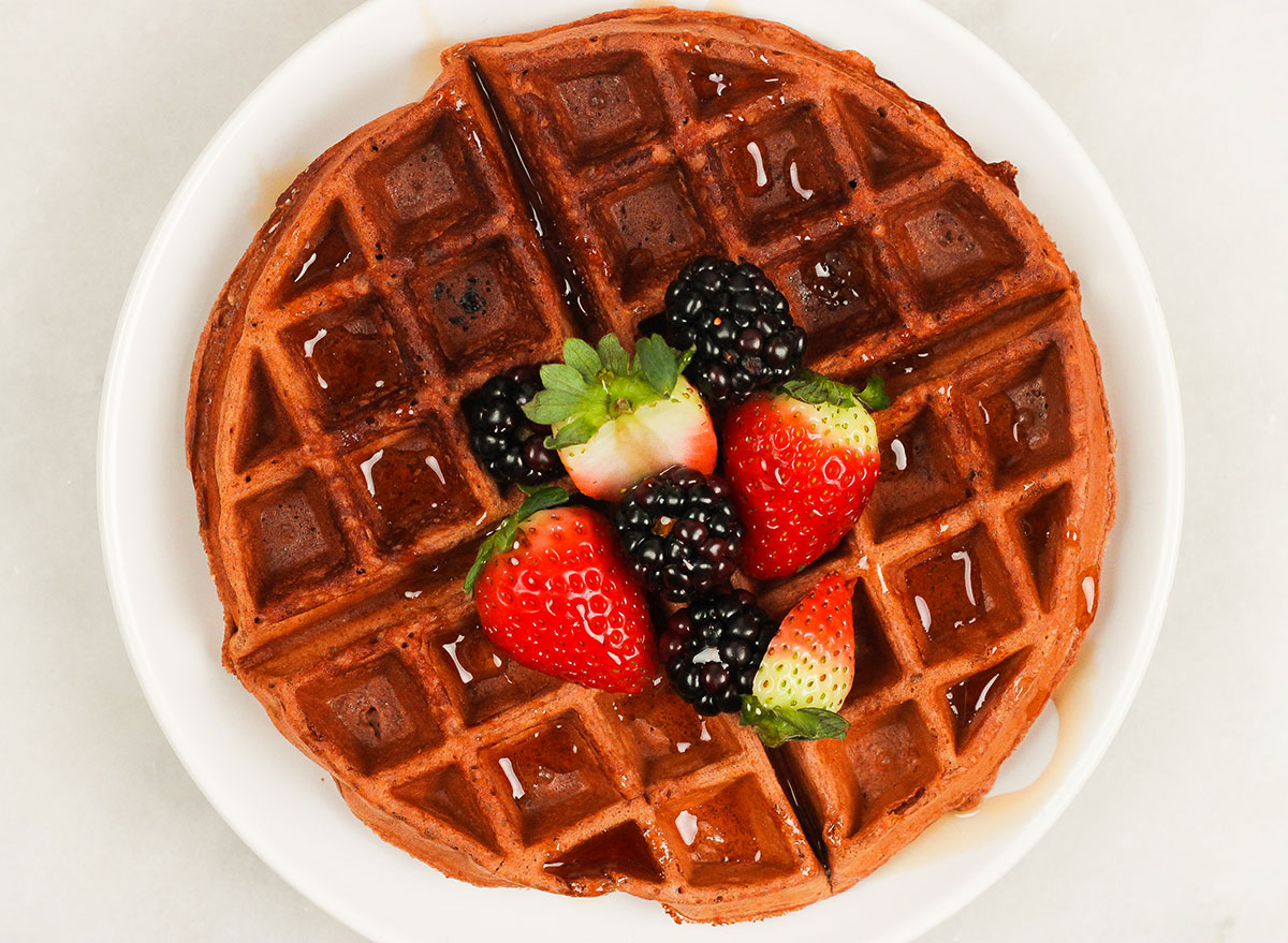 chocolate protein waffle with fresh berries on a plate