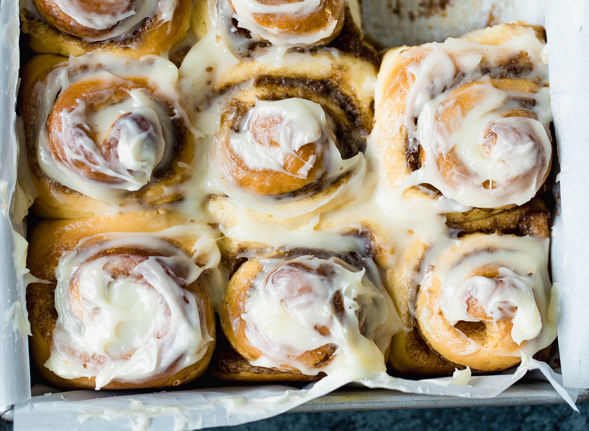 cinnamon rolls with frosting in baking pan