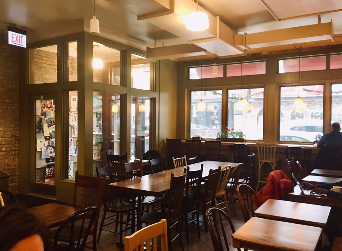 interior of colectivo coffee shop in chicago with tables and chairs
