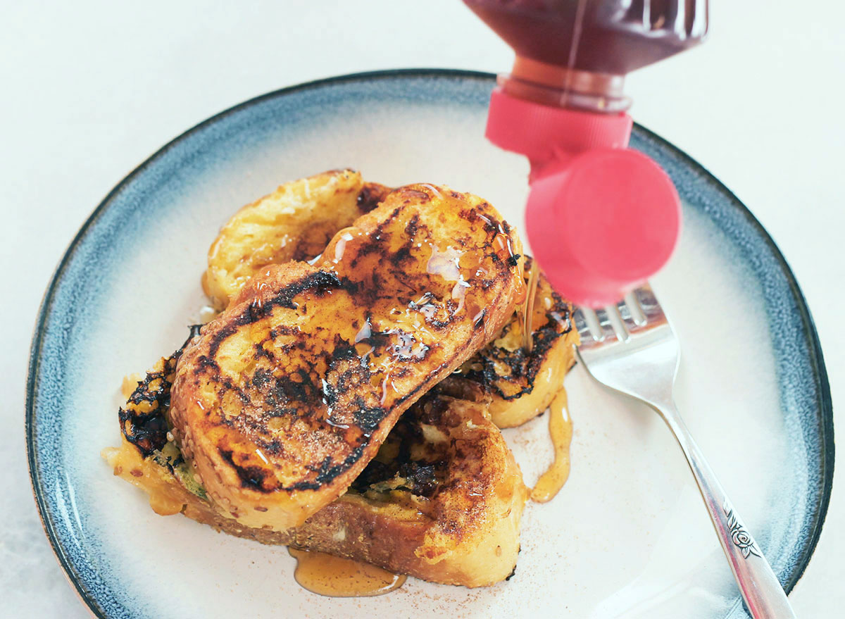 pouring syrup on french toast