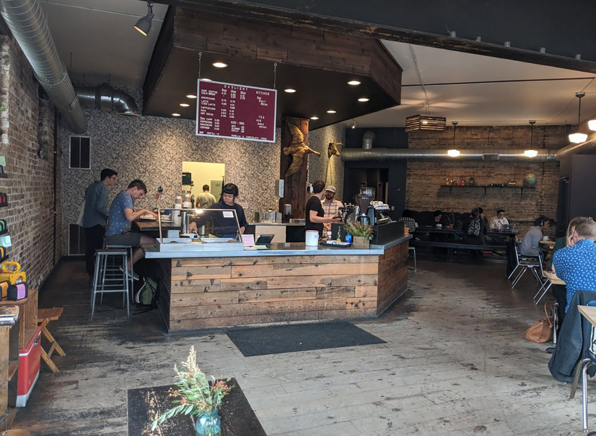 interior of gaslight coffee roasters in chicago with baristas and tables and seats