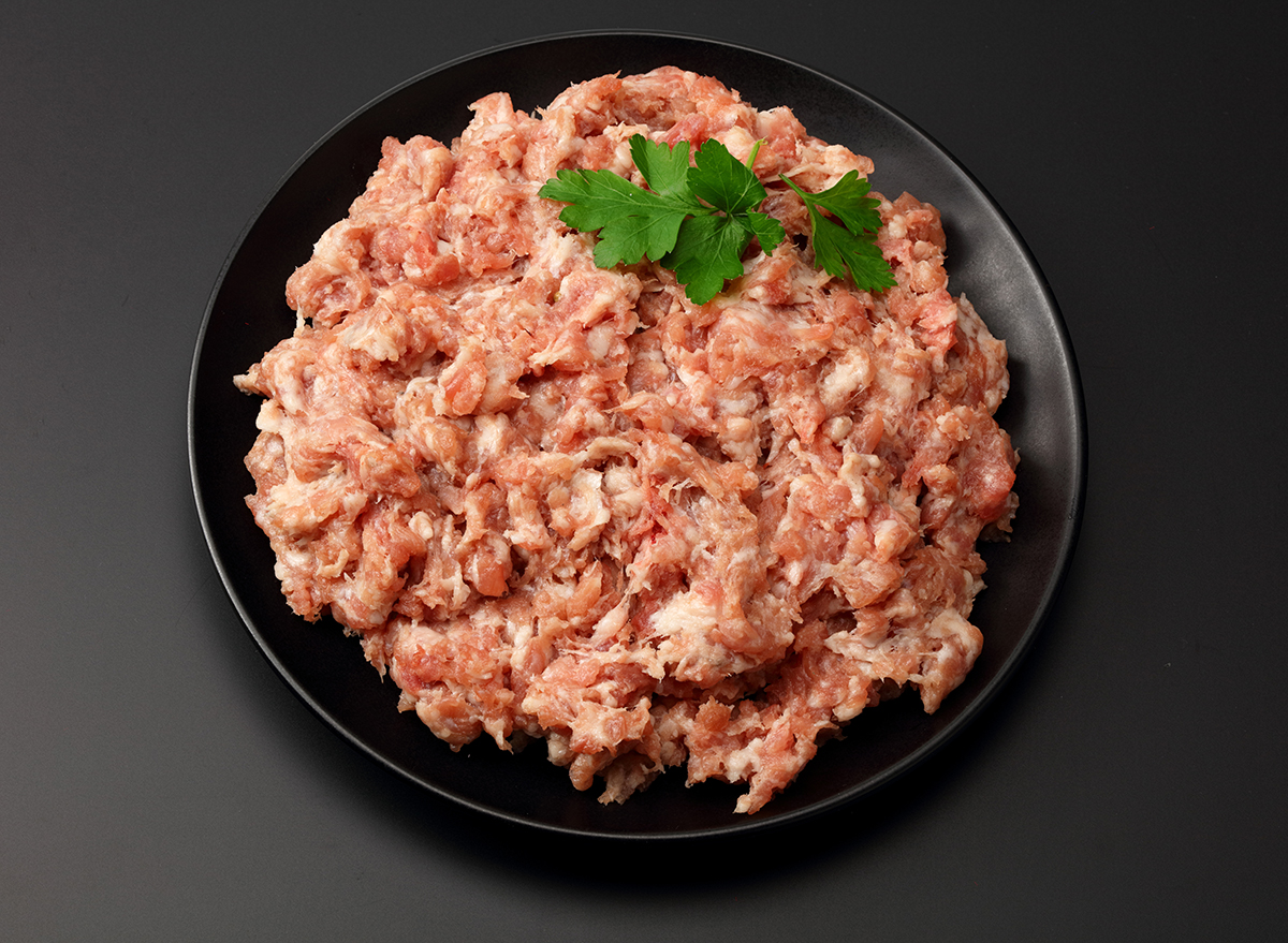 bowl of raw ground pork with seasoning