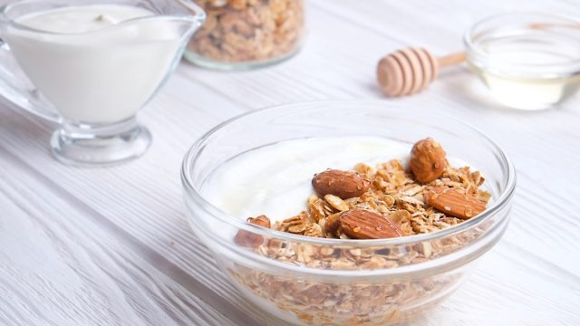 Glass bowl with Greek yogurt and mixed nuts