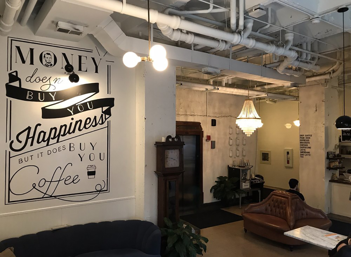 interior of heritage coffee bar in chicago with couch and coffee sign