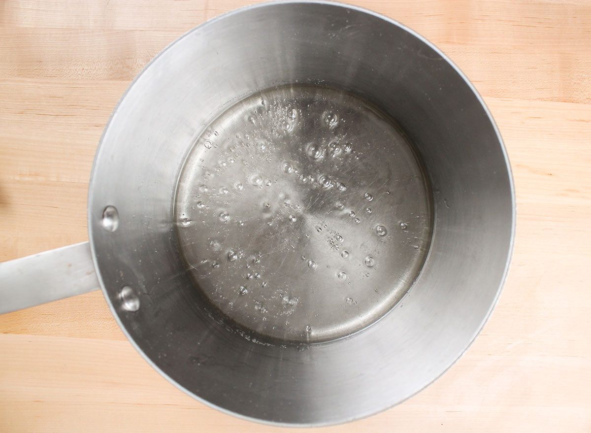 boiling sugar and water in a pot