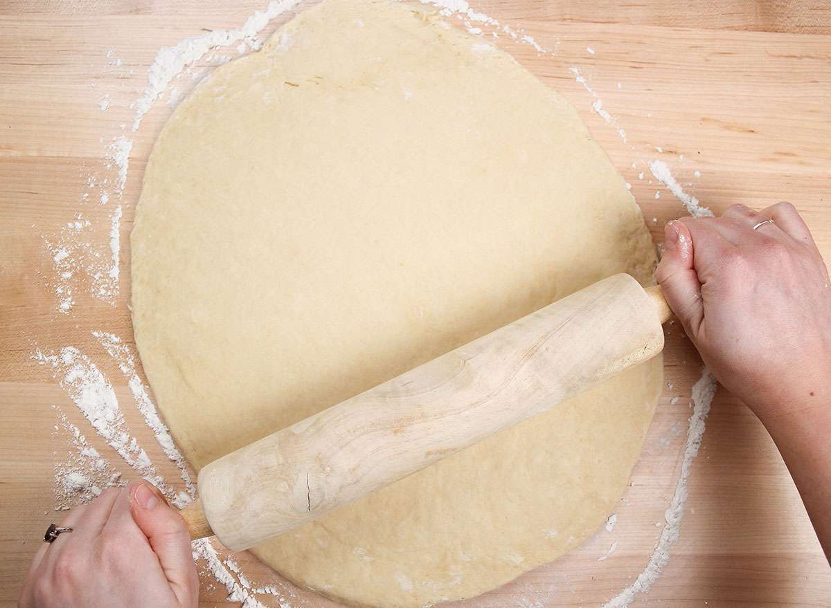 rolling out dough with a rolling pin