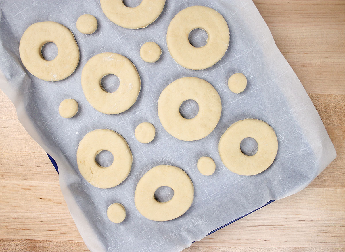 leaving the donut shapes to rise on a sheet pan