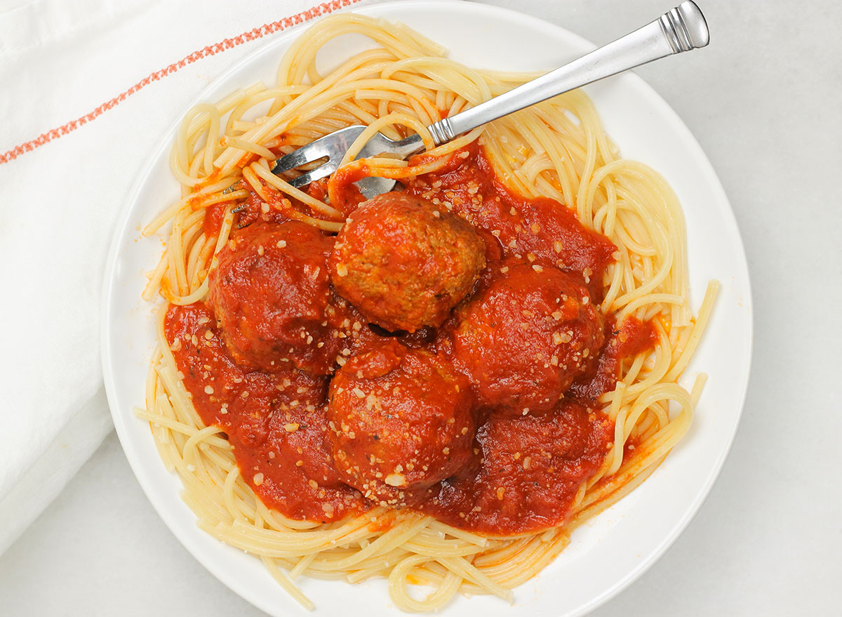 digging into a plate of Italian meatballs
