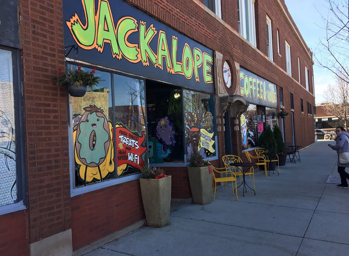 exterior storefront of jackalope coffee in chicago with window art donut