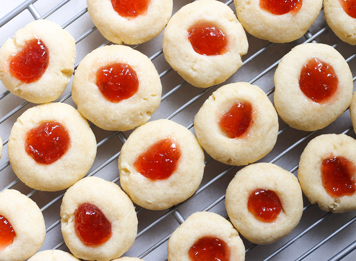 close up of thumbprint cookies on a cooling rack