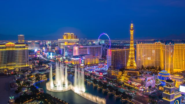 las vegas strip and skyline with eiffel tower replica and bellagio fountains