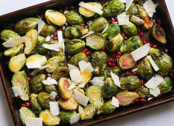 lemon pomegranate brussels sprouts on a sheet pan
