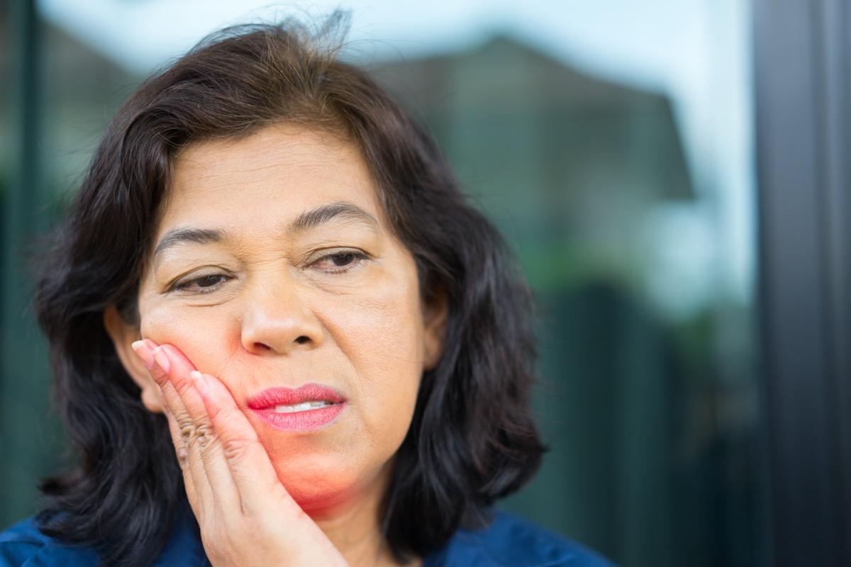 Asian Senior woman feeling tooth pain