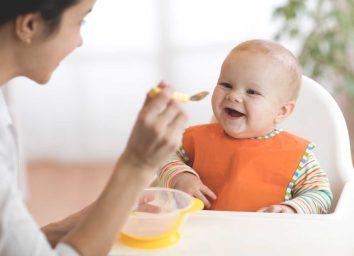 Mother feeding child baby food
