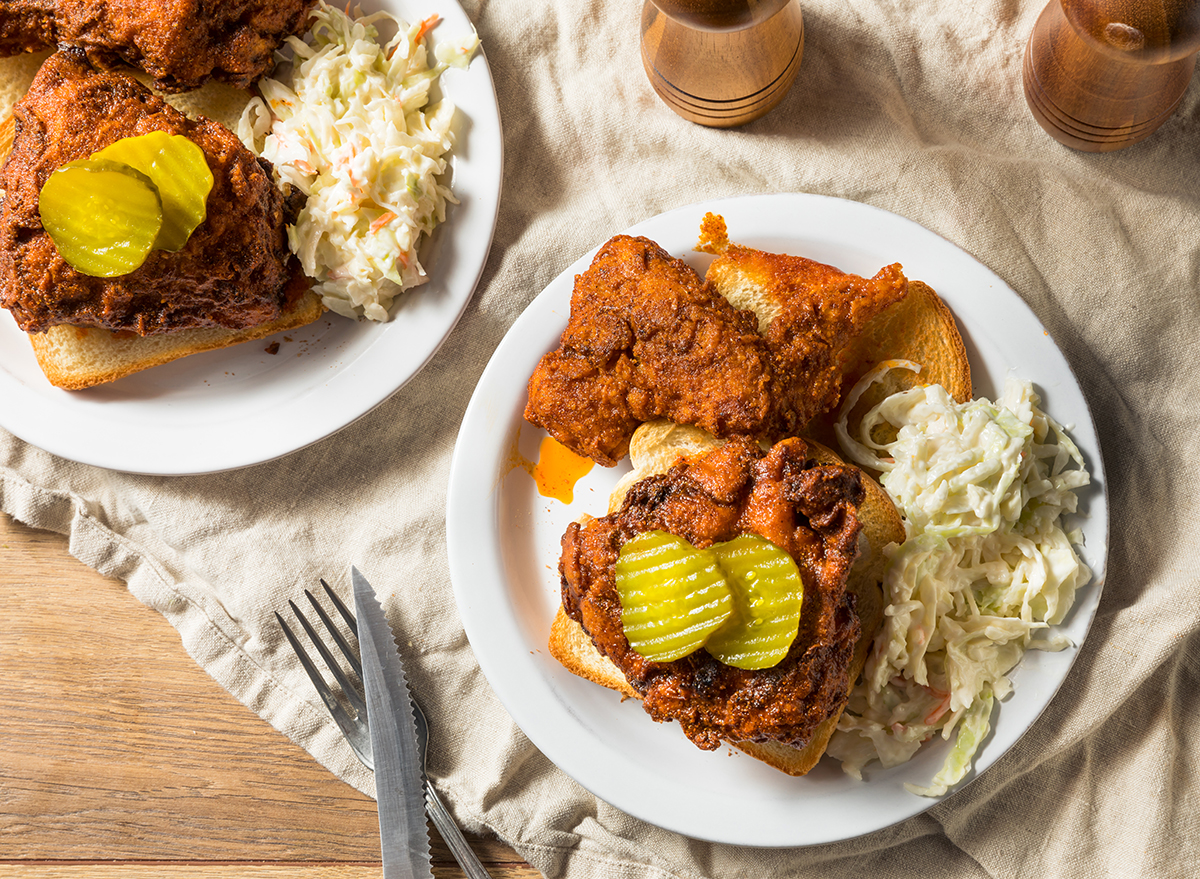 homemade plates of nashville hot chicken with pickles