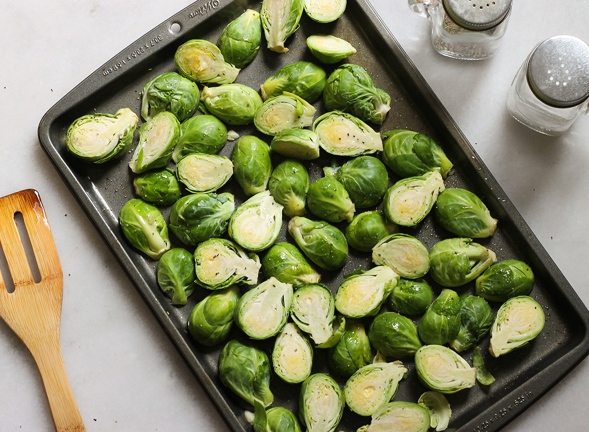 prepping brussels sprouts to be roasted in the oven