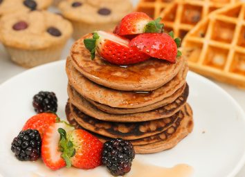pile of protein pancakes with waffles and muffins