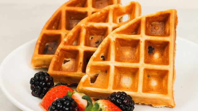 protein waffles on a plate with fresh berries