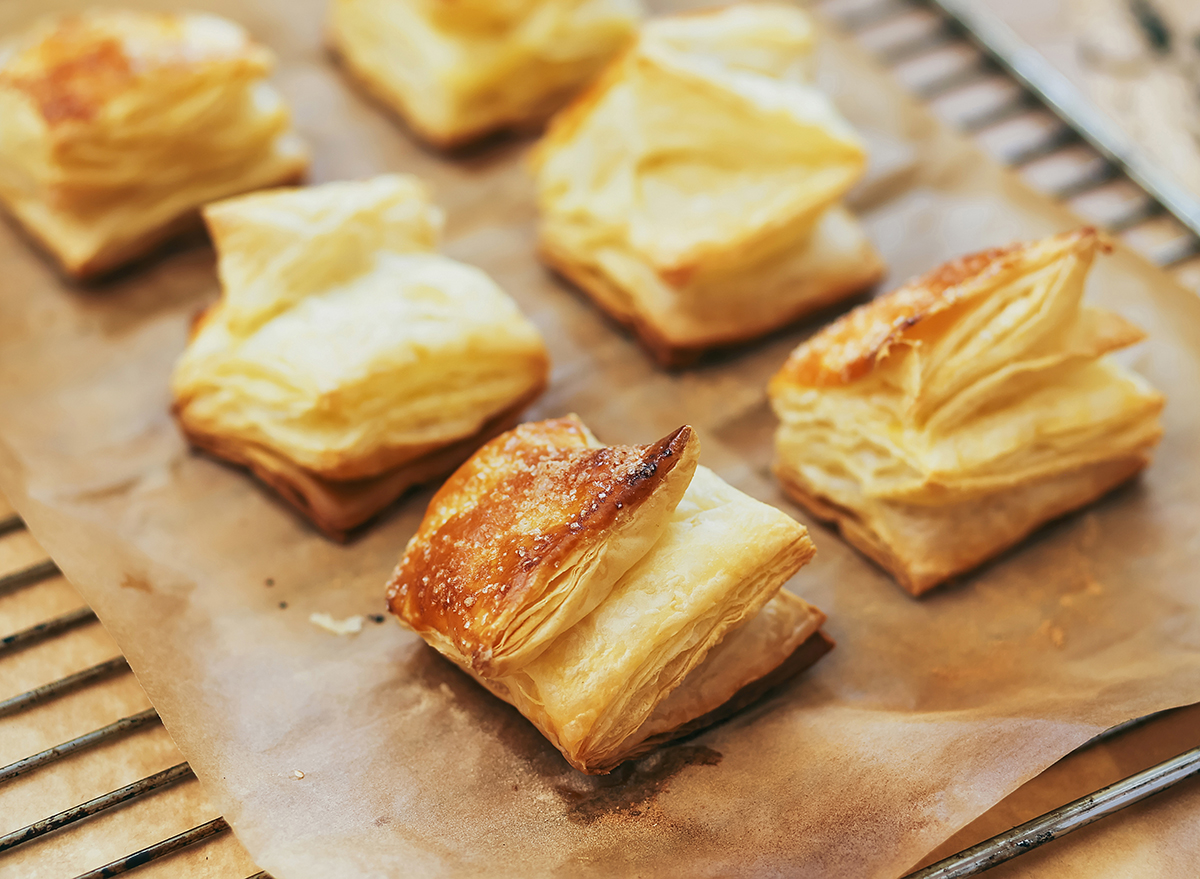 puff pastry rolls on parchment paper