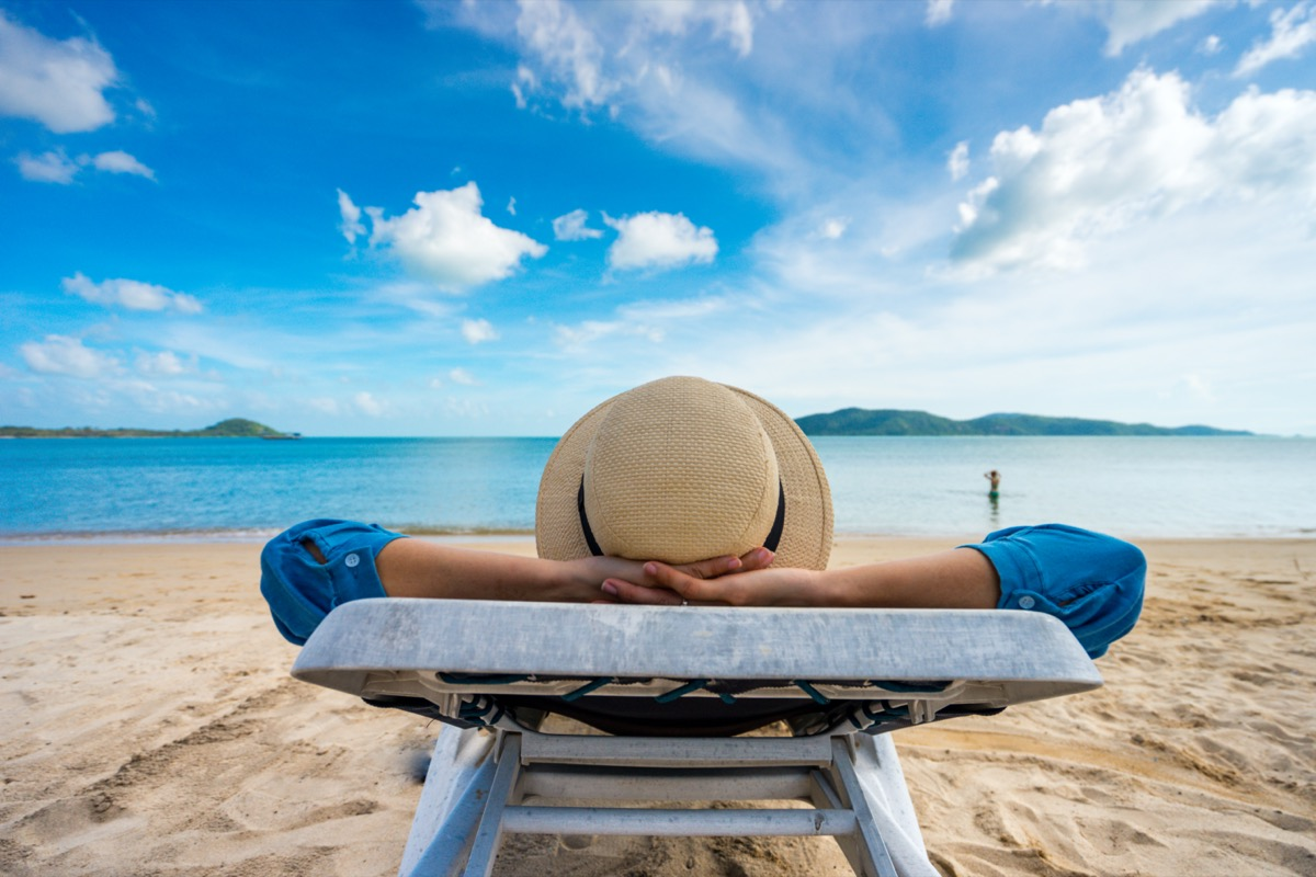 woman relaxing on beach, ocean view, Vacation Outdoors Seascape