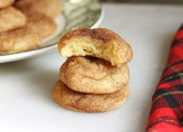 snickerdoodle cookies in a pile with a bite in one cookie
