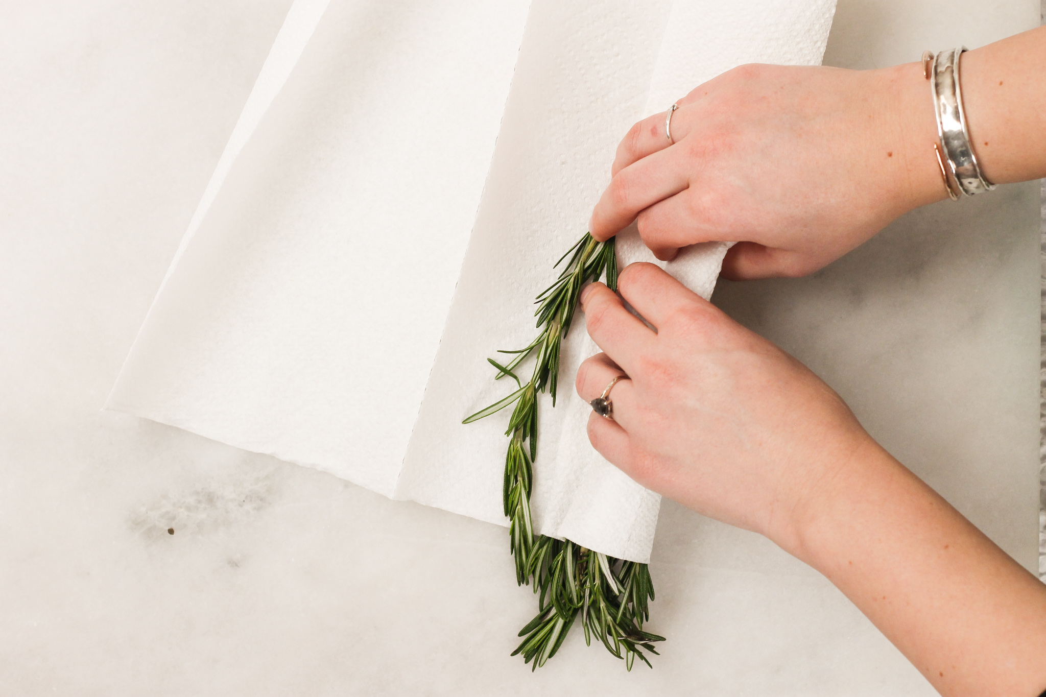 rolling rosemary in paper towels
