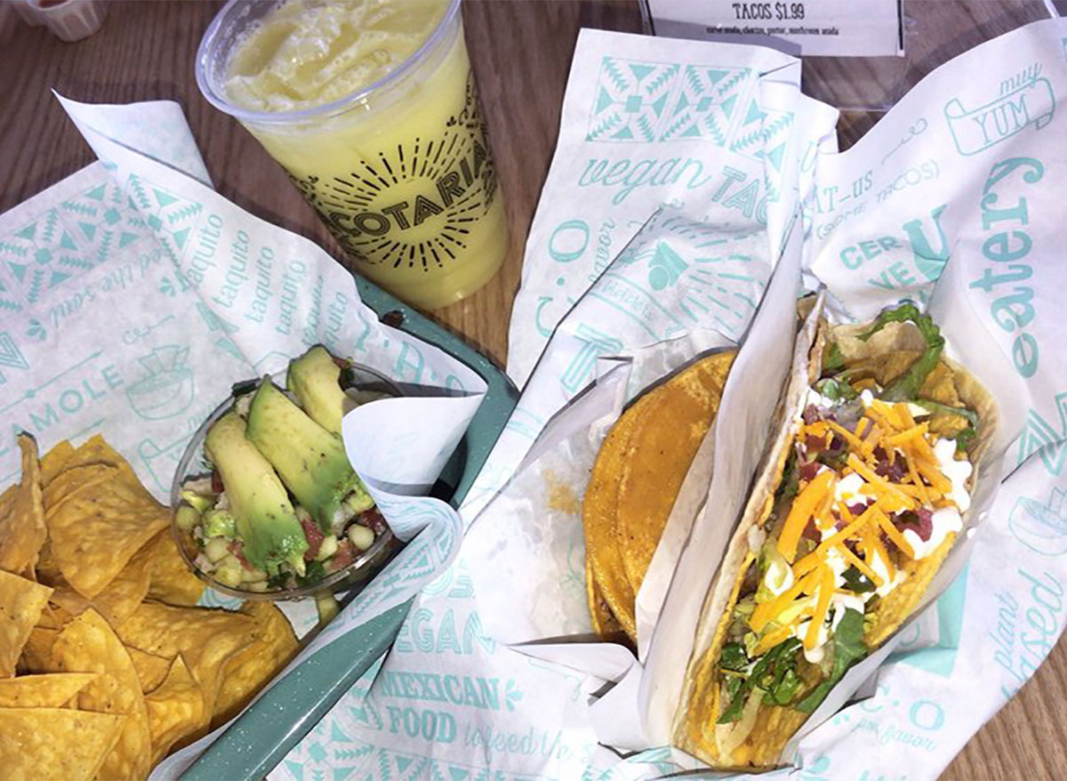 super taco with chips and drink