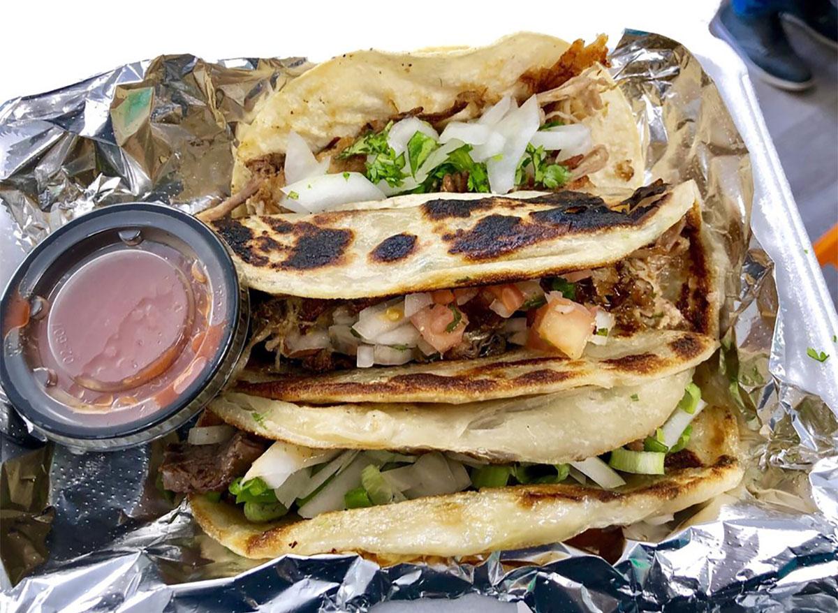 three tacos in a tray