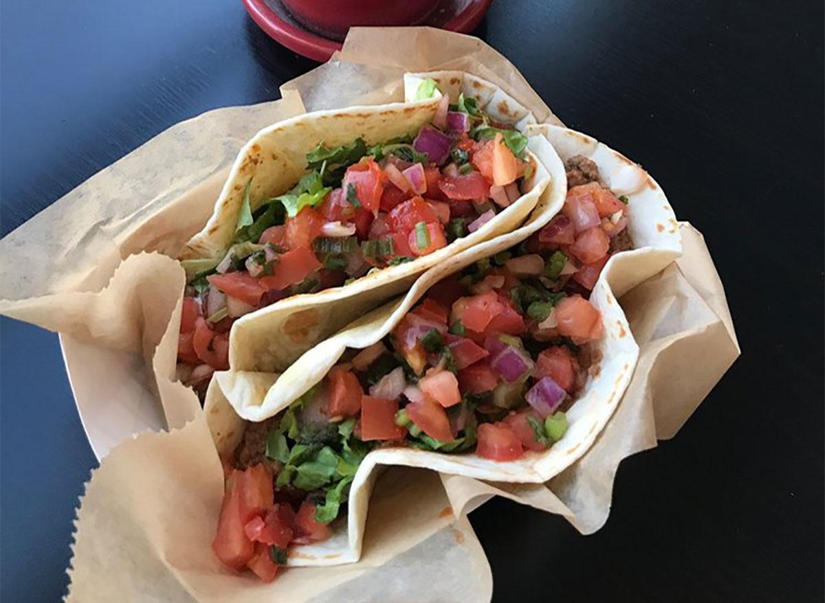 two tacos topped with pico de gallo