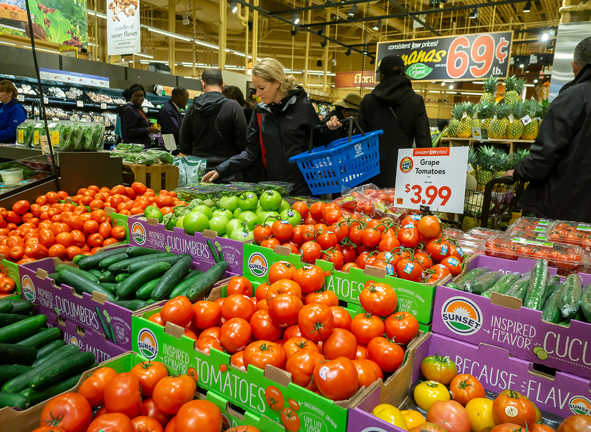 shoppers looking at vegetables in wegmans