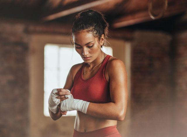 Female boxer wearing strap on wrist