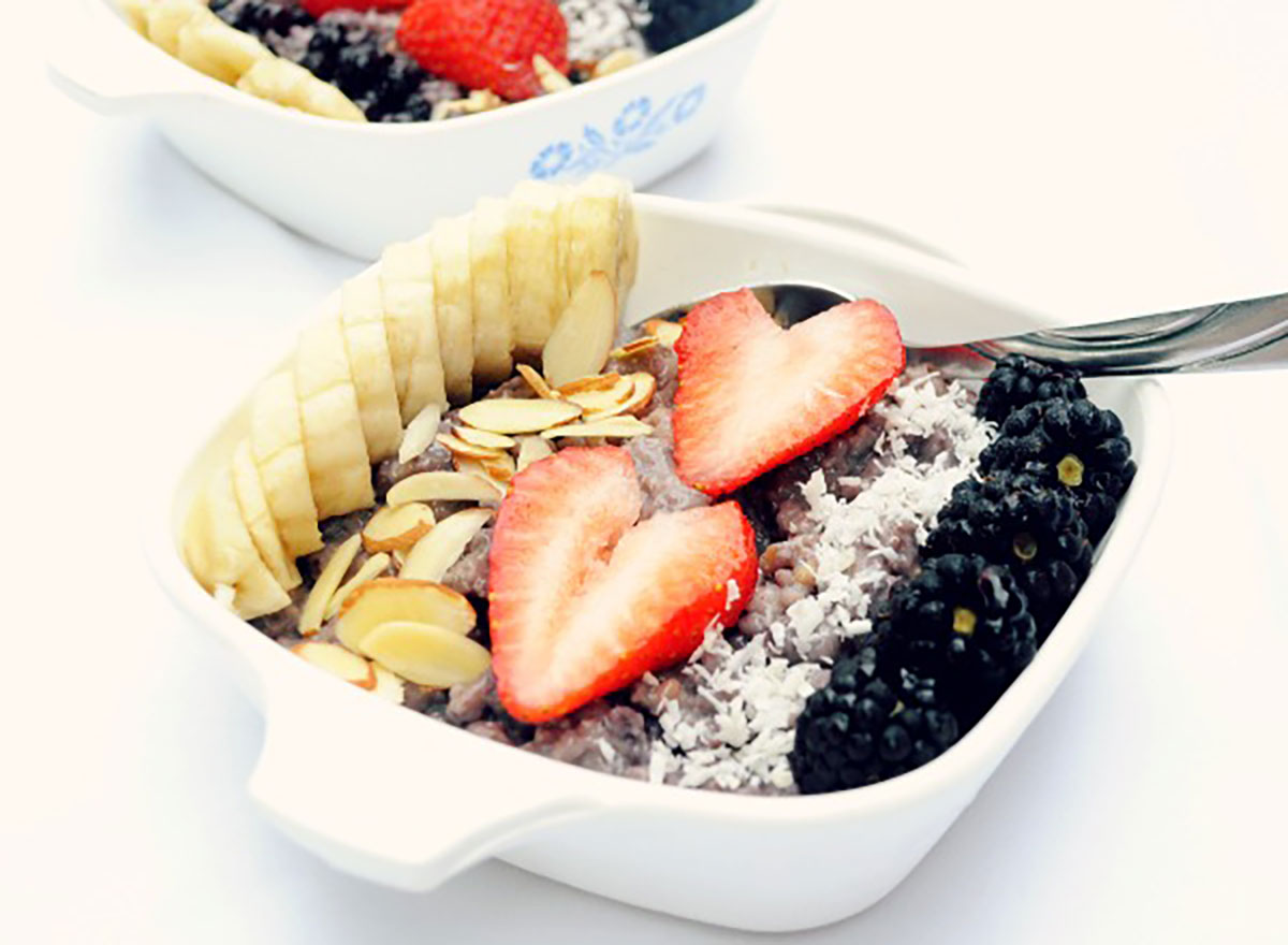 banana blueberry steel cut oatmeal topped with sliced bananas strawberries almonds coconut blackberries