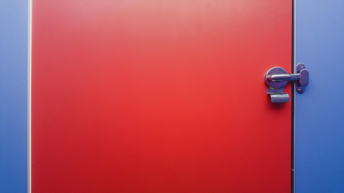 Public toilet partition door panel and stainless steel door lock.
