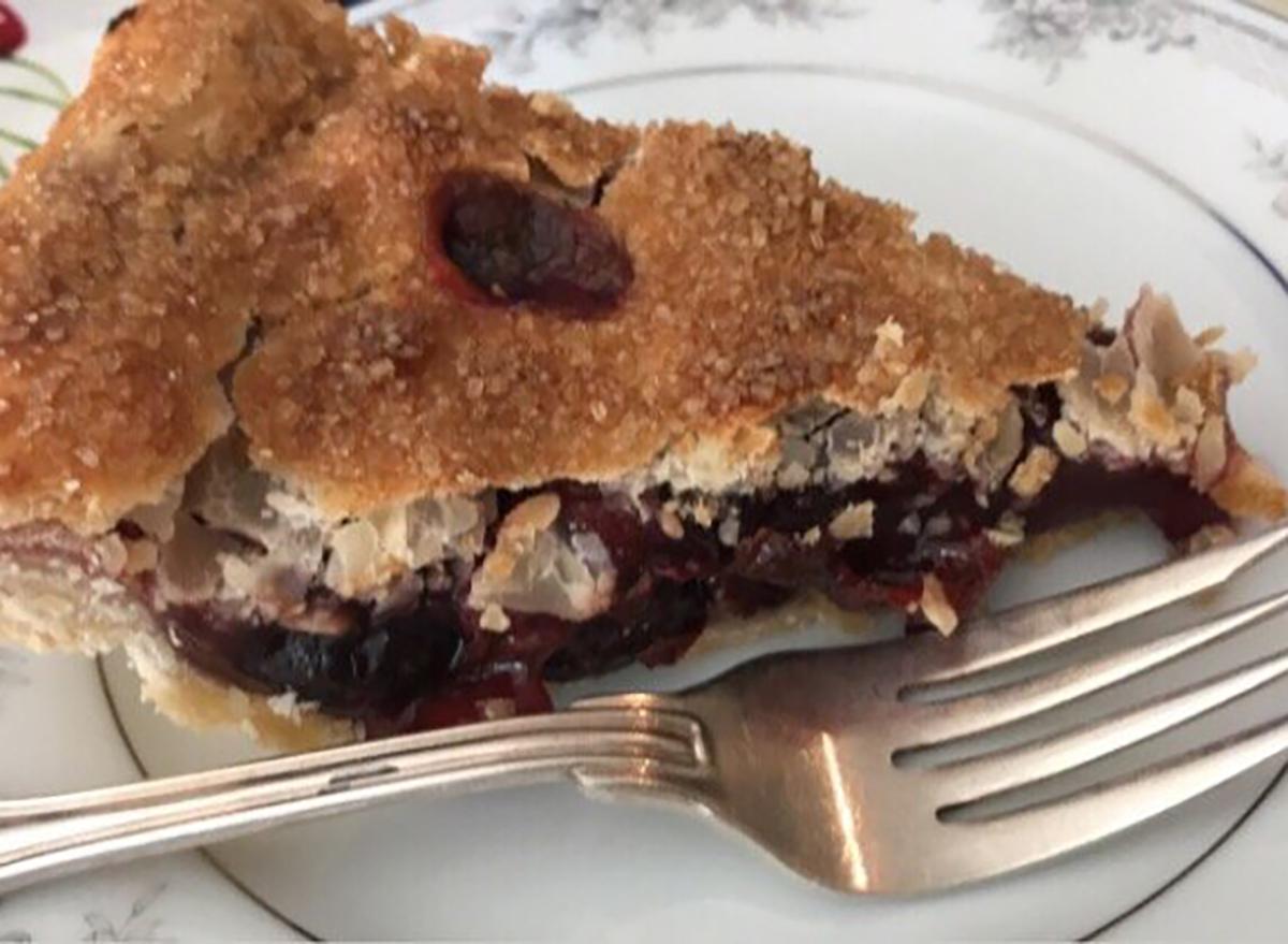 cherry pie slice with fork