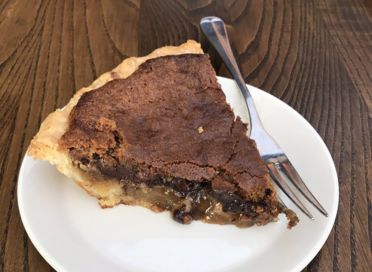 chocolate pecan pie slice on white plate