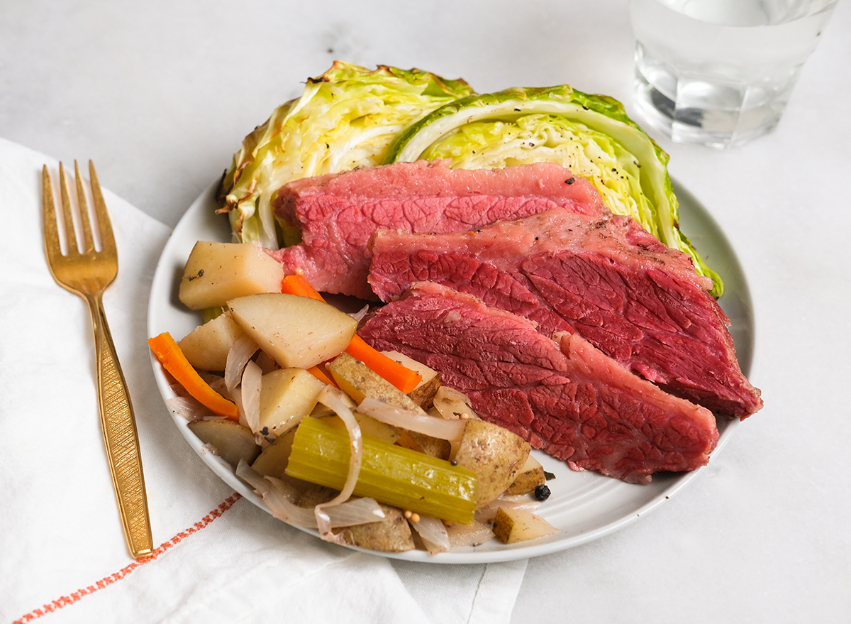 corned beef and cabbage on a plate with potatoes and vegetables