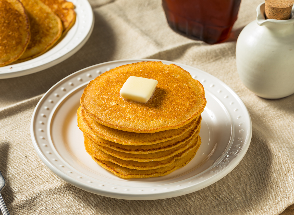 stack of cornmeal johnnycakes with butter
