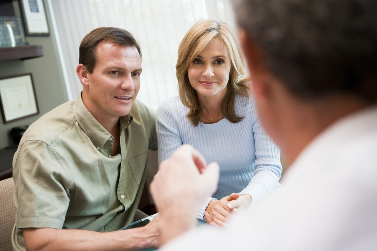 Couple in consultation at IVF clinic talking to doctor