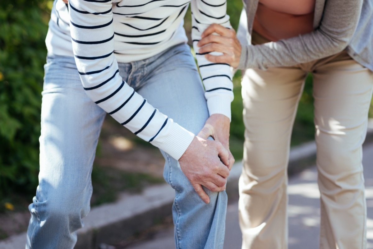 Elderly couple having pain in joints in the park
