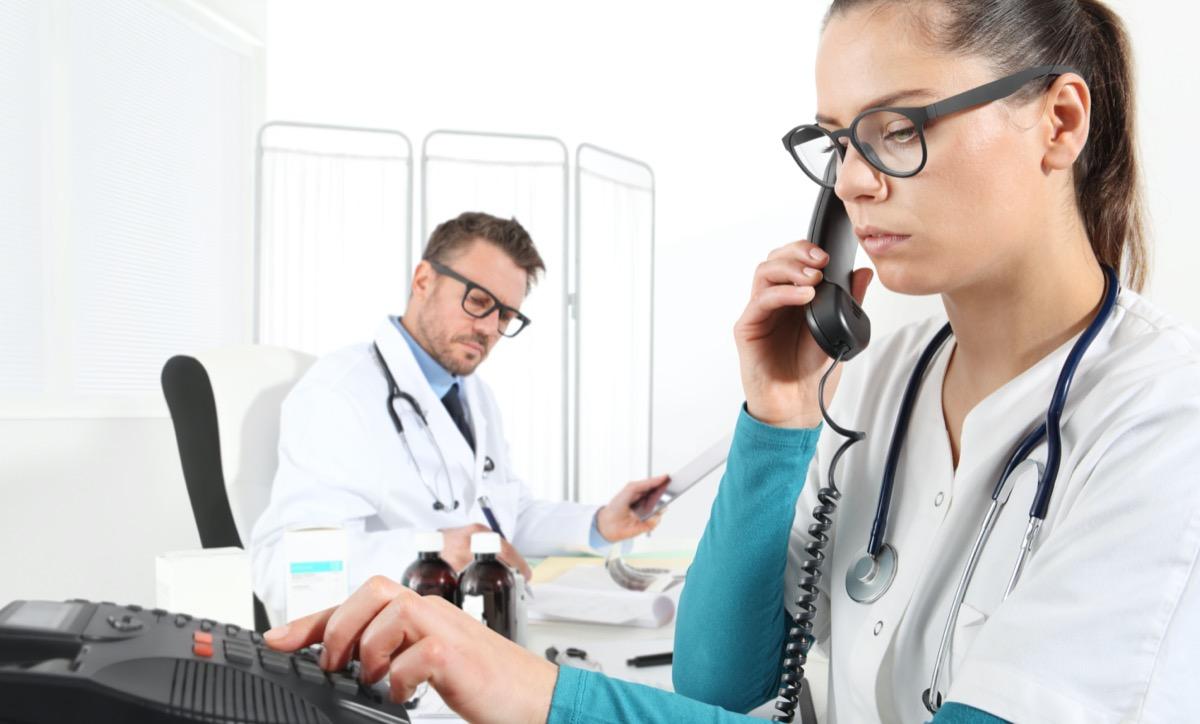 Doctors work at the desk