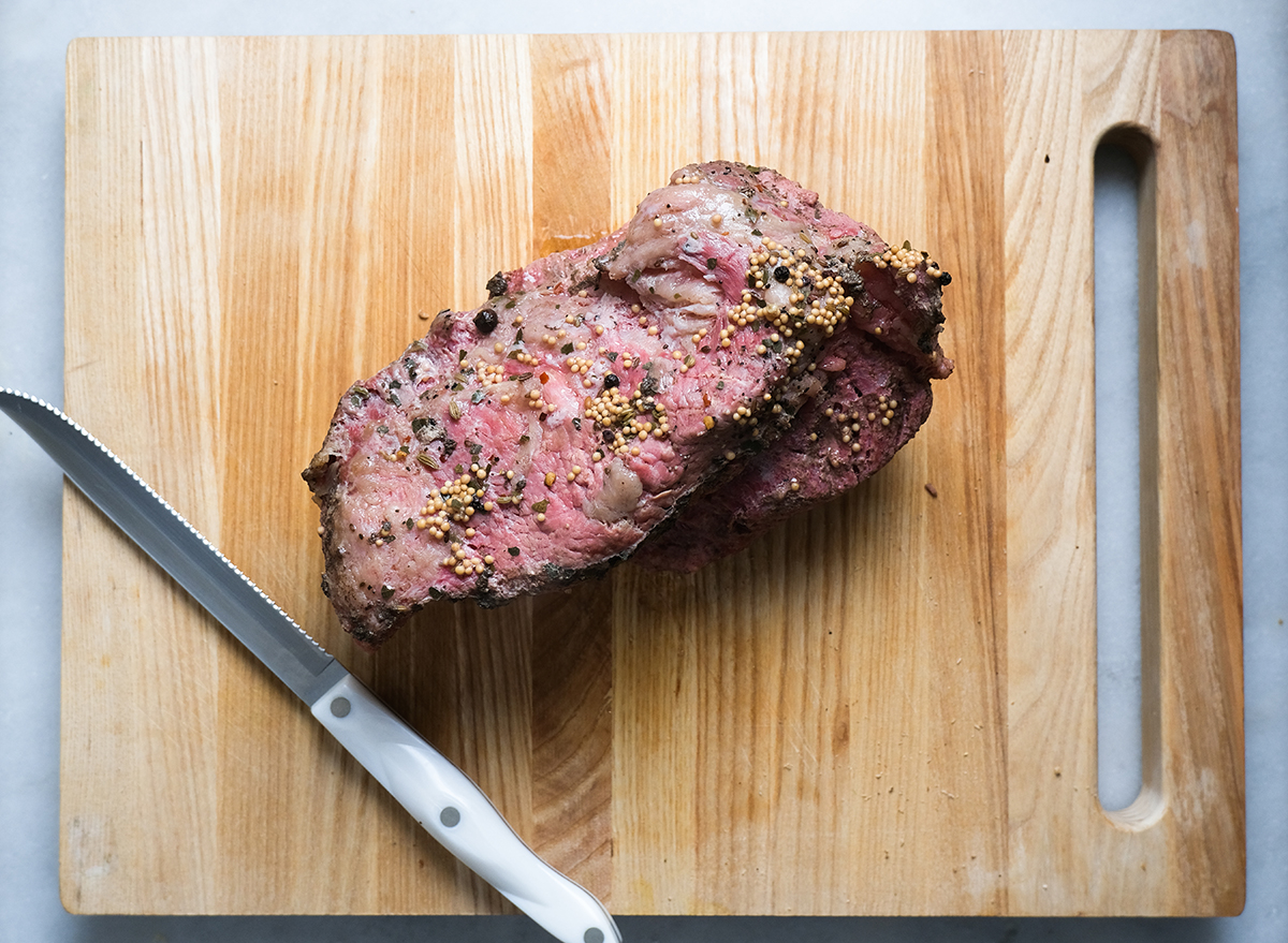 cooked corned beef on a cutting board