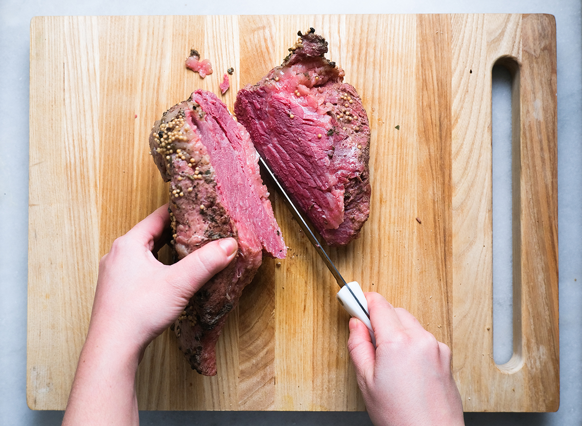 cutting into corned beef